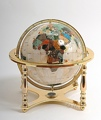 Mother of pearl globe. 4 legged stand gold. 33cm
